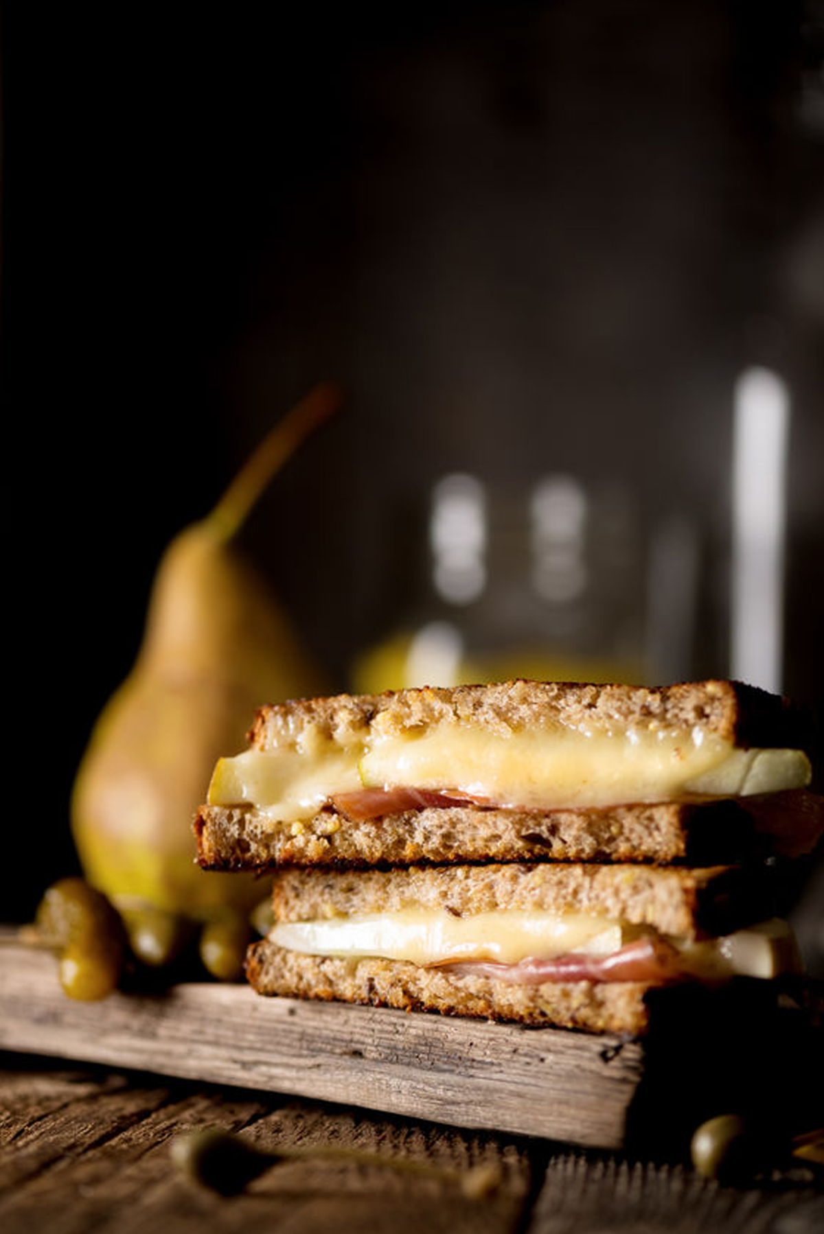 Grilled Cheese Sandwich with Prosciutto, Mild Cheddar and Pear.