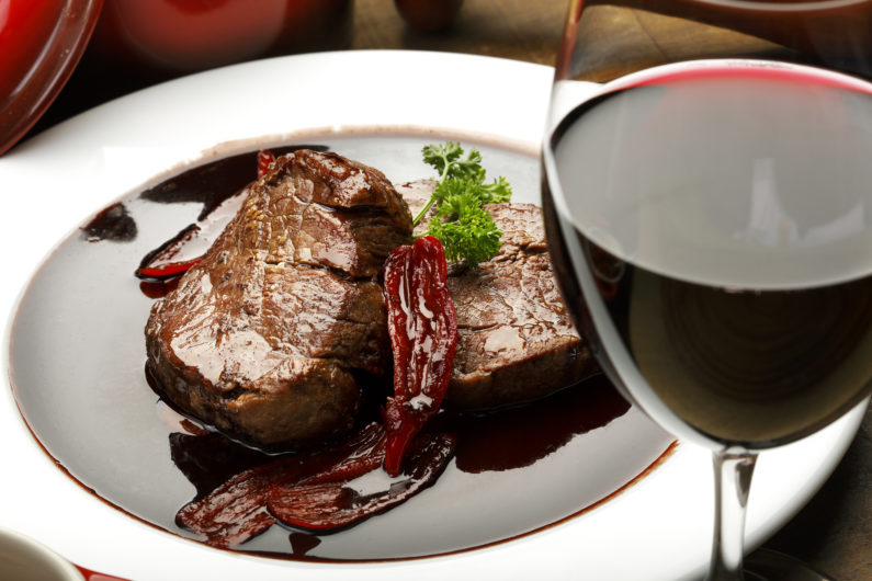 Tender Fillet Mignon in a red wine sauce with Seared Peppers